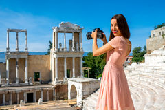 Tourist photographing Roman theater in Plovdiv. Young woman tourist photographing Roman theater of Philippopolis in Plovdiv, Bulgaria stock image