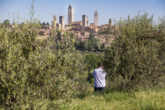 Tourist photographing San Gimignano Stock Photo