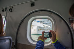 Tourist photographing in sea plane Stock Photos
