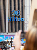 Tourist photographing the sign of Hilton hotel, NYC. Royalty Free Stock Images