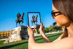 Tourist photographing Skanderbeg monument stock image