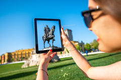 Tourist photographing Skanderbeg monument Royalty Free Stock Photography