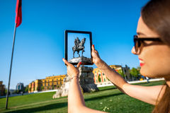 Tourist photographing Skanderbeg monument stock images