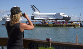 Tourist photographing space shuttle. Tourist photographing US Space Shuttle floating on a barge Stock Photo