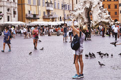 tourist photographing with tablet in Piazza Navona in Rome Royalty Free Stock Photo