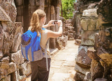 Tourist photographing the temple in Angkor, Cambodia Stock Photos