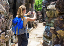 Tourist photographing in the temple. Angkor, Cambodia Royalty Free Stock Image