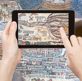 Tourist photographs of ancient Holy Land map Royalty Free Stock Photo