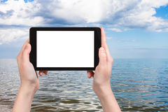 tourist photographs of Azov Sea on tablet pc Royalty Free Stock Photography