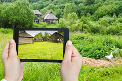 Tourist photographs of backyard in village Royalty Free Stock Photo