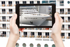 Tourist photographs of big cruise liner Stock Photos
