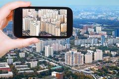 Tourist photographs of block of modern houses Stock Photo