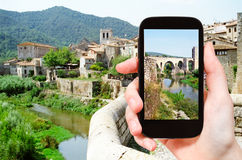 Tourist photographs of bridge in Besalu town Stock Photos