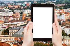 Tourist photographs Brno city skyline on tablet Royalty Free Stock Photos