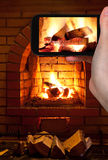 Tourist photographs of burning wood in fireplace Stock Photos