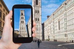Tourist photographs campanile in Florence Stock Photos