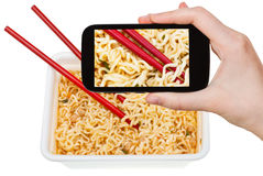 Tourist photographs of cooked instant ramen Stock Image
