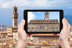 Tourist photographs facade of Palazzo Vecchio Stock Images