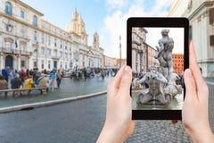Tourist photographs fountain on piazza Navona Stock Photography