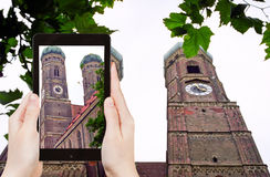Tourist photographs Frauenkirche church in Munich Stock Images