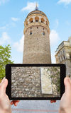 Tourist photographs of Galata tower in Istanbul Royalty Free Stock Images