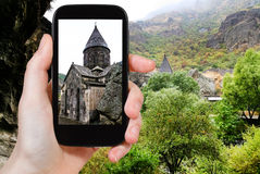 Tourist photographs geghard monastery in Armenia Royalty Free Stock Photo