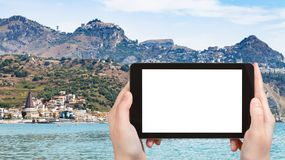 Tourist photographs Giardini-Naxos and Taormina. Travel concept - tourist photographs Giardini-Naxos town and Taormina city on cape in Sicily Italy in summer Royalty Free Stock Images
