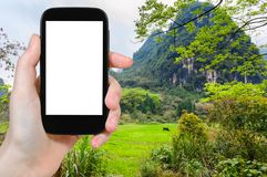 tourist photographs green meadow in Yangshuo Stock Images