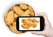 Tourist photographs of hot fried chicken wings Stock Photography