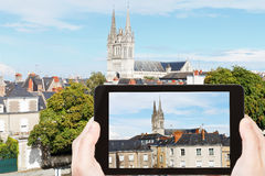 Tourist photographs houses and Cathedral in Angers Royalty Free Stock Image