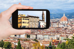 Tourist photographs houses in Florence city Royalty Free Stock Images