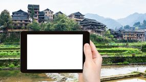 tourist photographs houses and terraced gardens Royalty Free Stock Photography
