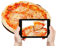 Tourist photographs of italian pizza Margherita Royalty Free Stock Photography