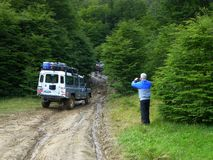 Tourist photographs a jeep on an impassable road,  Tierra del Fuego, Argentina royalty free stock images