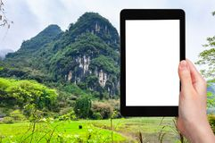 tourist photographs karst mountain in Yangshuo Royalty Free Stock Image