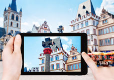 Tourist photographs of market square in Trier Stock Photo