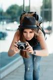 Tourist photographs with mirrorless digital camera. Royalty Free Stock Photo