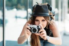 Tourist photographs with mirrorless digital camera. Stock Image