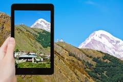 Tourist photographs Mount Kazbek in Georgia Stock Images