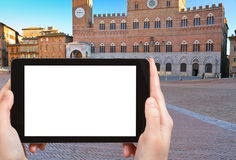 Tourist photographs Piazza del Campo in Siena, Italy Royalty Free Stock Photos