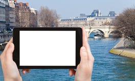 Tourist photographs of Pont Neuf in Paris Royalty Free Stock Photos