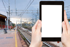 Tourist photographs of railroad station in evening Stock Photography