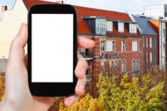 Tourist photographs residential building in Berlin Royalty Free Stock Photos