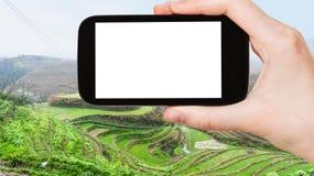 tourist photographs Rice Terraces near Tiantouzhai Royalty Free Stock Images