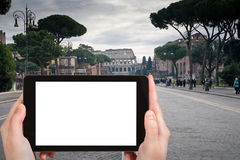 Tourist photographs road to Coliseum, Rome Royalty Free Stock Photo
