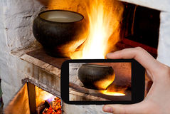 Tourist photographs of russian stove and iron pot Royalty Free Stock Image