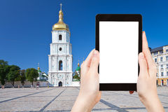 Tourist photographs Saint Sophia Cathedral , Kiev. Travel concept - tourist photograph bell tower and Saint Sophia Cathedral through Sophia square in Kiev stock image