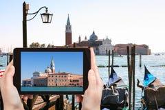 Tourist photographs San Giorgio Maggiore in Venice Stock Image