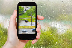 Tourist photographs of shower in city Stock Images