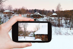 Tourist photographs of snowy wooden houses Stock Photography